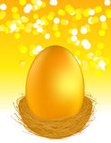 Golden egg on glare light background Stock Image
