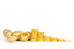 Golden egg and gold coin Royalty Free Stock Photo