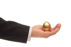 Golden Egg in Hand. Man's Hand with a Golden Egg Nested in His Palm Royalty Free Stock Photos
