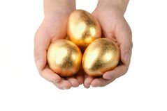 Golden egg in the hands Royalty Free Stock Photos