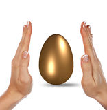 Golden Egg and hands Royalty Free Stock Photography