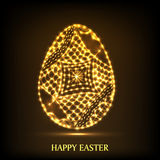 Golden egg for Happy Easter celebration. Floral decorated shiny golden egg for Happy Easter celebration on brown background Royalty Free Stock Photos