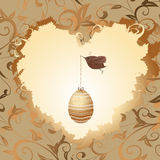 Golden egg in the heart of a bird Royalty Free Stock Image