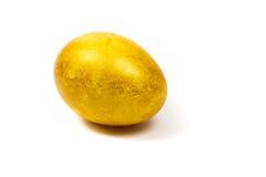 Golden egg. Isolated on white background. Macro. Selective focus stock photo