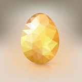 Golden egg from the mosaics, pattern, triangles for Easter. Stock Image