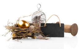 Golden egg in nest with blackboard Royalty Free Stock Images