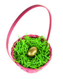Golden egg nestled in a pink easter basket Stock Photography