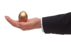 Golden Egg In Palm of Hand Stock Photography