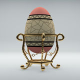Golden egg on pedestal.Red egg with pattern Royalty Free Stock Images