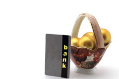 Golden egg in porcelain chalice and bank card Royalty Free Stock Photo