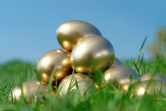Golden egg pyramid Stock Photography