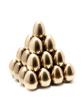 Golden egg pyramid Royalty Free Stock Image