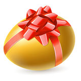 Golden egg with red bow Royalty Free Stock Photo