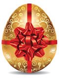 Golden Egg with Red Bow Stock Photos