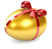 Golden Egg. With red ribbon Stock Image