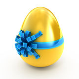 Golden egg with ribbon Royalty Free Stock Photos