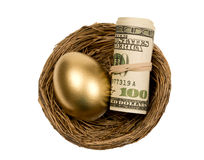 Golden Egg With Roll Of Money In Nest. Nice combination of a golden egg and a roll of money together in a nest. Isolated on white background stock image