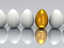 Golden egg in a row of the white eggs Stock Photo