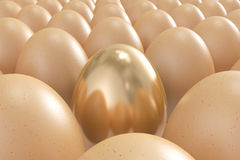 Golden egg standing out from the crowd Royalty Free Stock Photography