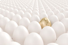 Golden egg standing out from the crowd. High quality 3d image of a golden egg standing out from the crowd Stock Photography