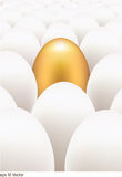 Golden egg standing out from the others Royalty Free Stock Photo