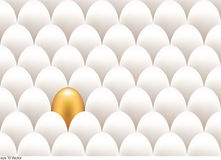 Golden egg standing out from the others Royalty Free Stock Images
