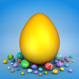 Golden egg surrounded by Easter eggs Royalty Free Stock Photography