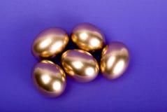Golden eggs. Stock Photos