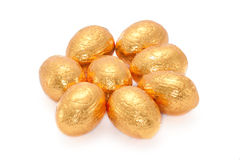 Golden Eggs. Mini Golden Chocolate Eggs  on White Background Royalty Free Stock Image