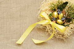 Golden eggs. In the nest on a canvas background Stock Photo