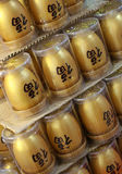 Golden Eggs. Golden eggs with chinese words for chinese new year Stock Images