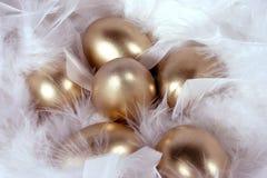 Golden eggs. Golden easter eggs in nest Royalty Free Stock Images
