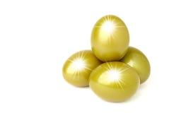 Golden eggs. Four golden eggs with star burst royalty free stock image