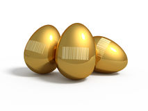 Golden eggs with barcodes. Three golden eggs with barcodes isolated Royalty Free Stock Image