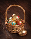 Golden eggs in a basket. Easter div concept Royalty Free Stock Image