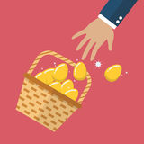 Golden eggs in basket slipped out of the hand Stock Photography