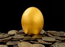 Golden eggs on black background Royalty Free Stock Photos