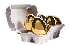 Golden eggs in box Royalty Free Stock Photo
