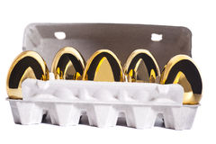 Golden eggs in box Stock Images