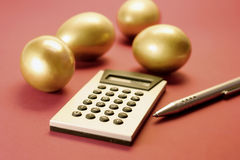 Golden Eggs with Calculator Stock Photography
