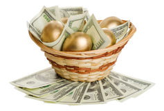 Golden eggs and dollars in a basket isolated Royalty Free Stock Photo
