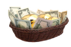 Golden eggs and dollars in basket isolated on white Stock Photos