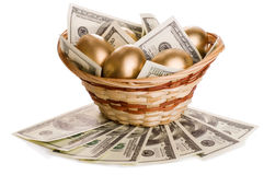 Golden eggs and dollars in a basket  Royalty Free Stock Images