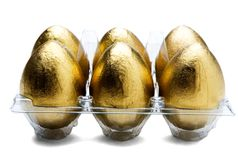 Golden Eggs In Egg Carton Royalty Free Stock Photography