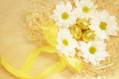 Golden eggs and flowers for Easter Stock Photography