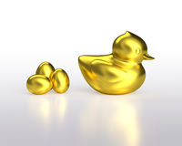 Golden eggs and gold duck Stock Images