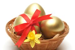 Golden Eggs In Basket Royalty Free Stock Images