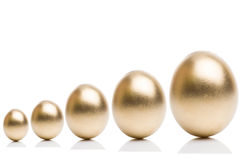 Golden eggs from  isolated on a white background. Stock Photography