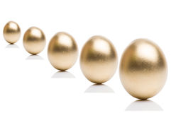 Golden eggs from  isolated on a white background. Royalty Free Stock Images