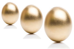 Golden eggs from  isolated on a white background. Royalty Free Stock Photos